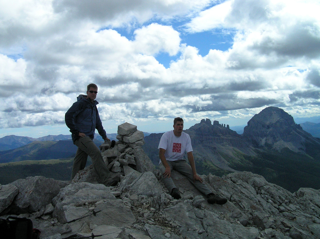Summit photo. Seven Sisters and Crowsnest Mountain in the background.