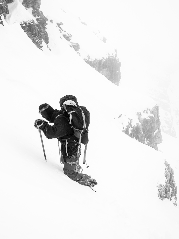 Dropping into the snow gully - carefully kicking firm steps to avoid an uncontrolled descent.