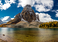 A great view of Mount Assiniboine and Sunburst Peak from the shoreline of Cerulean Lake.