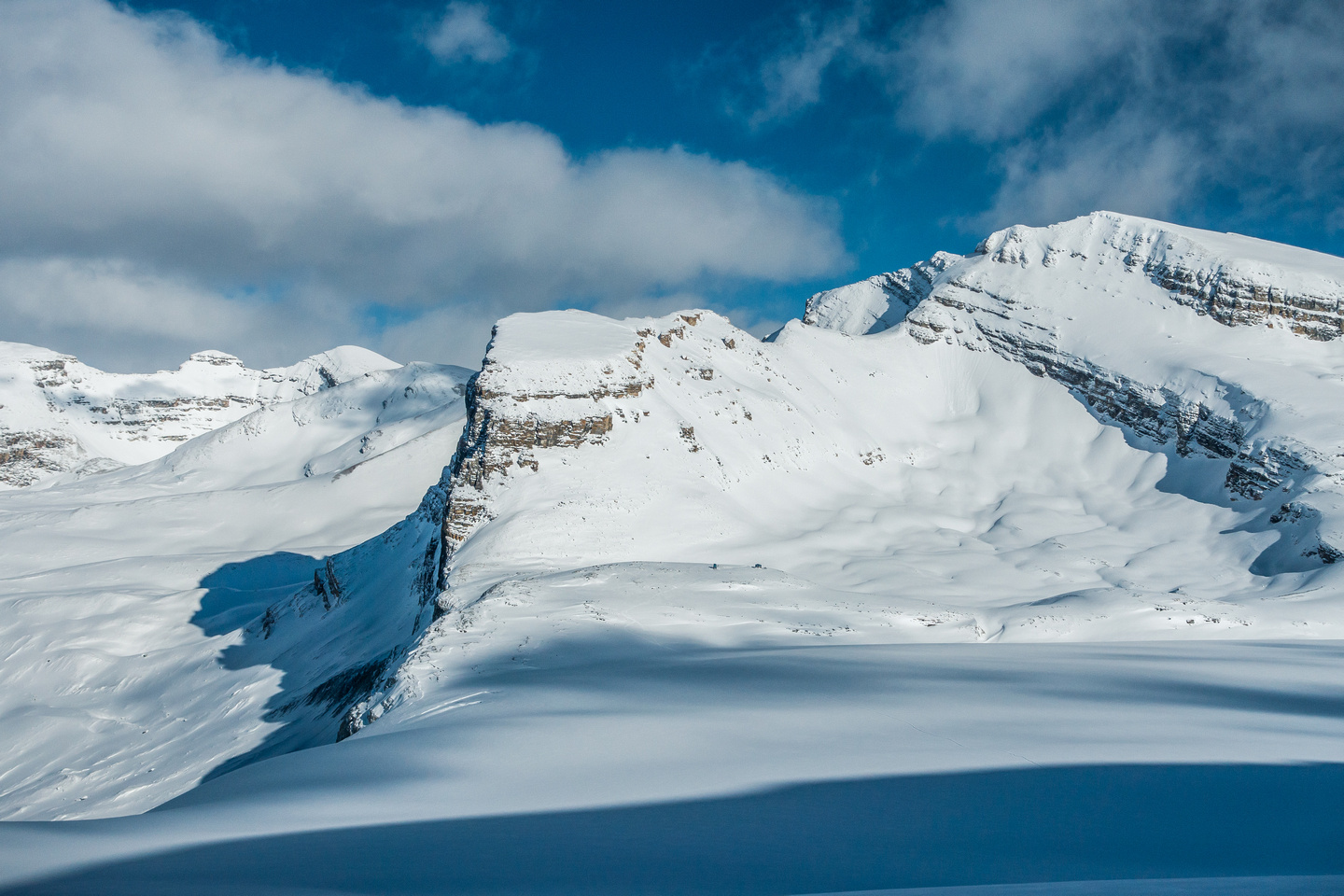 Looking back over Peyto Hut at Mount Thompson as I follow Steven and Ben's track to the Baker / Tilley col