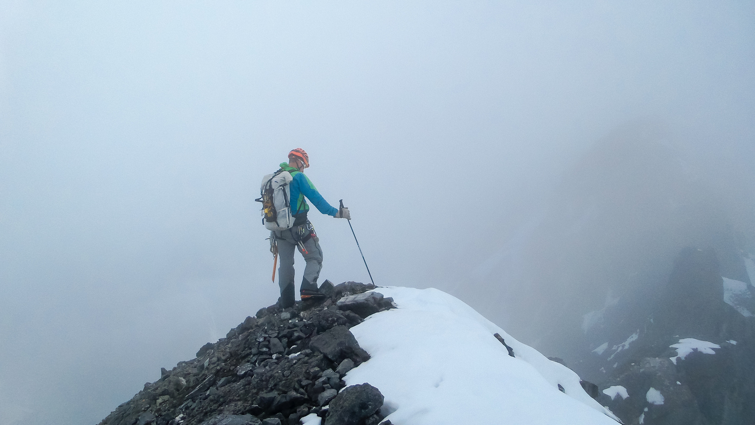 Vern climbs on in the clouds - photo by Steven Song.