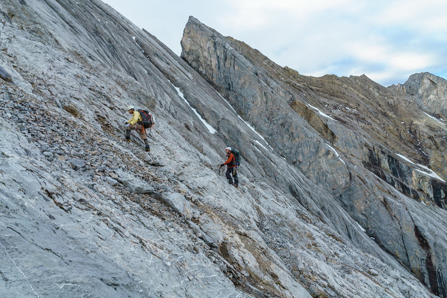 Typical slab climbing on the SW face as we contour back to the west ridge.