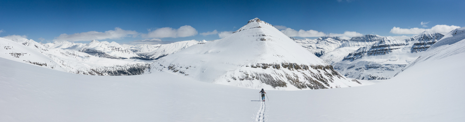 Eric comes up the icefield with BBP in the background.