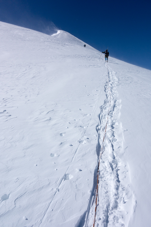 Heading up to steep slopes just before the summit.