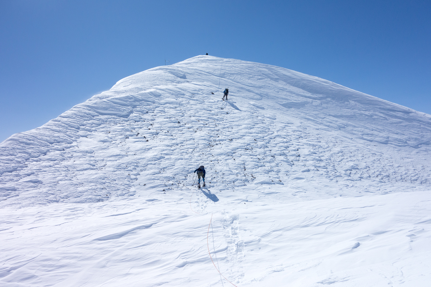 The summit is visible! One last scree / snow slope.