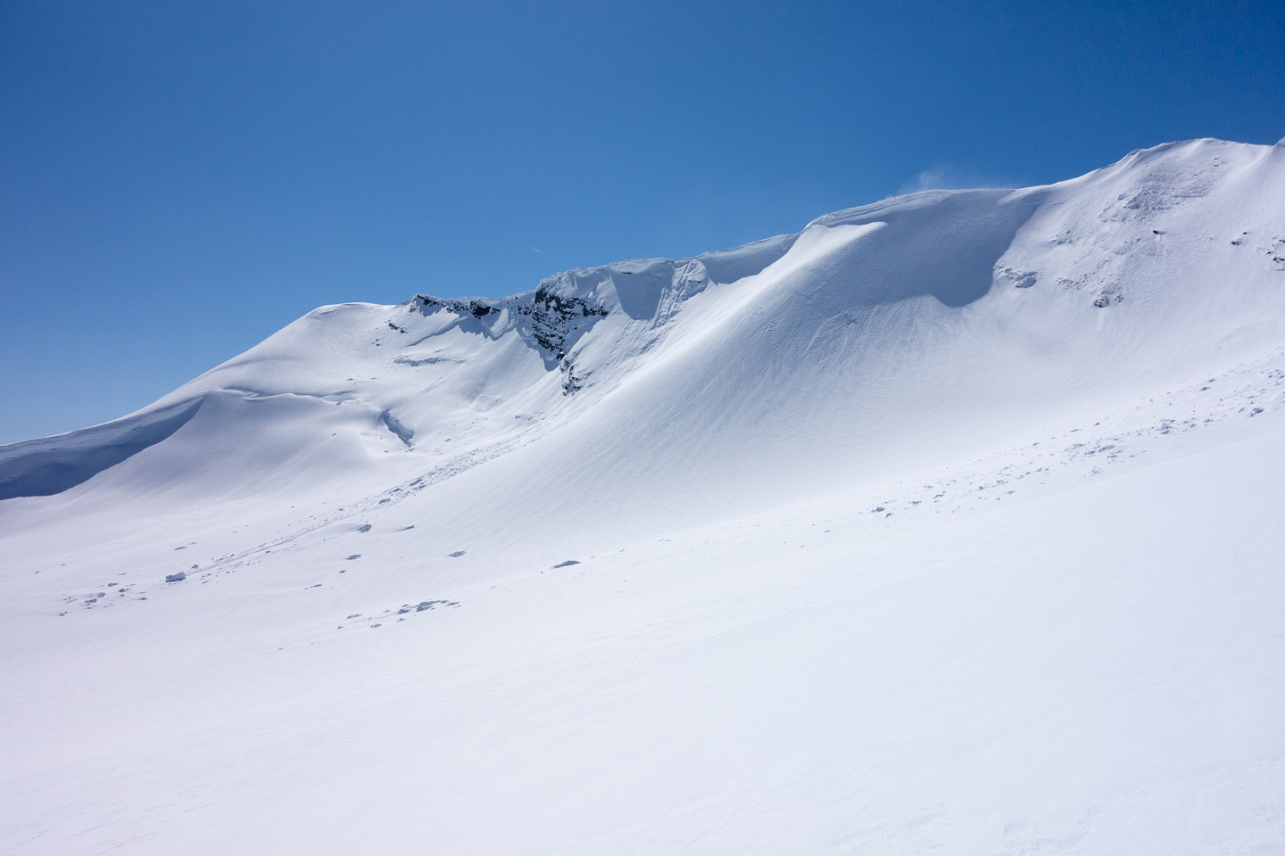 Note the cornice failure that we triggered en route from the summit above.