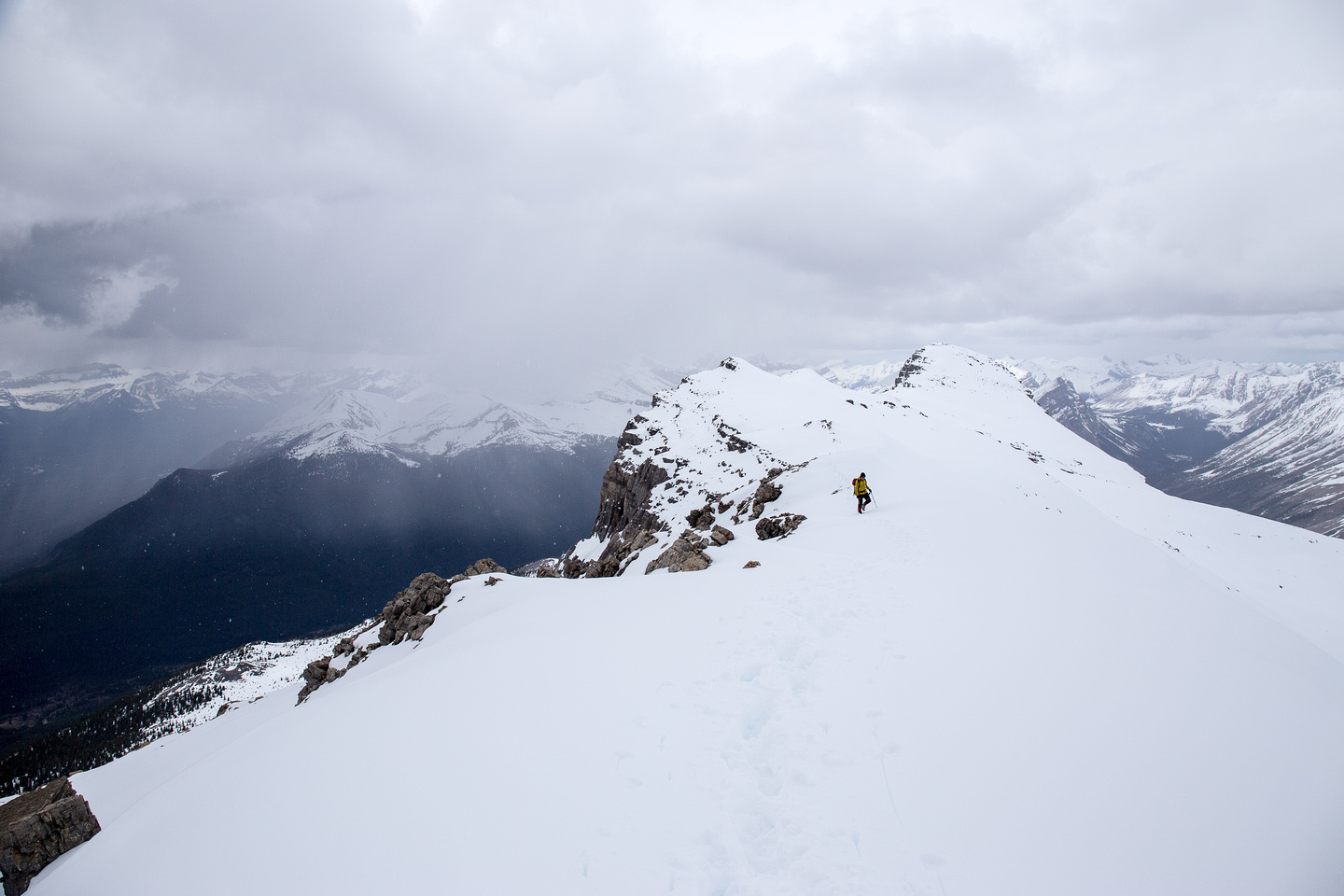 Looking back at the peak and the threatening skies.
