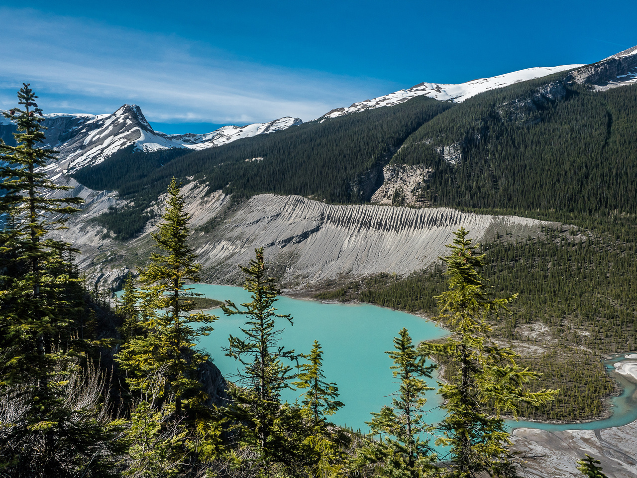 A gorgeous view over Lyell Lake showing the moraine that is used to access the Lyell Meadows and Icefield.