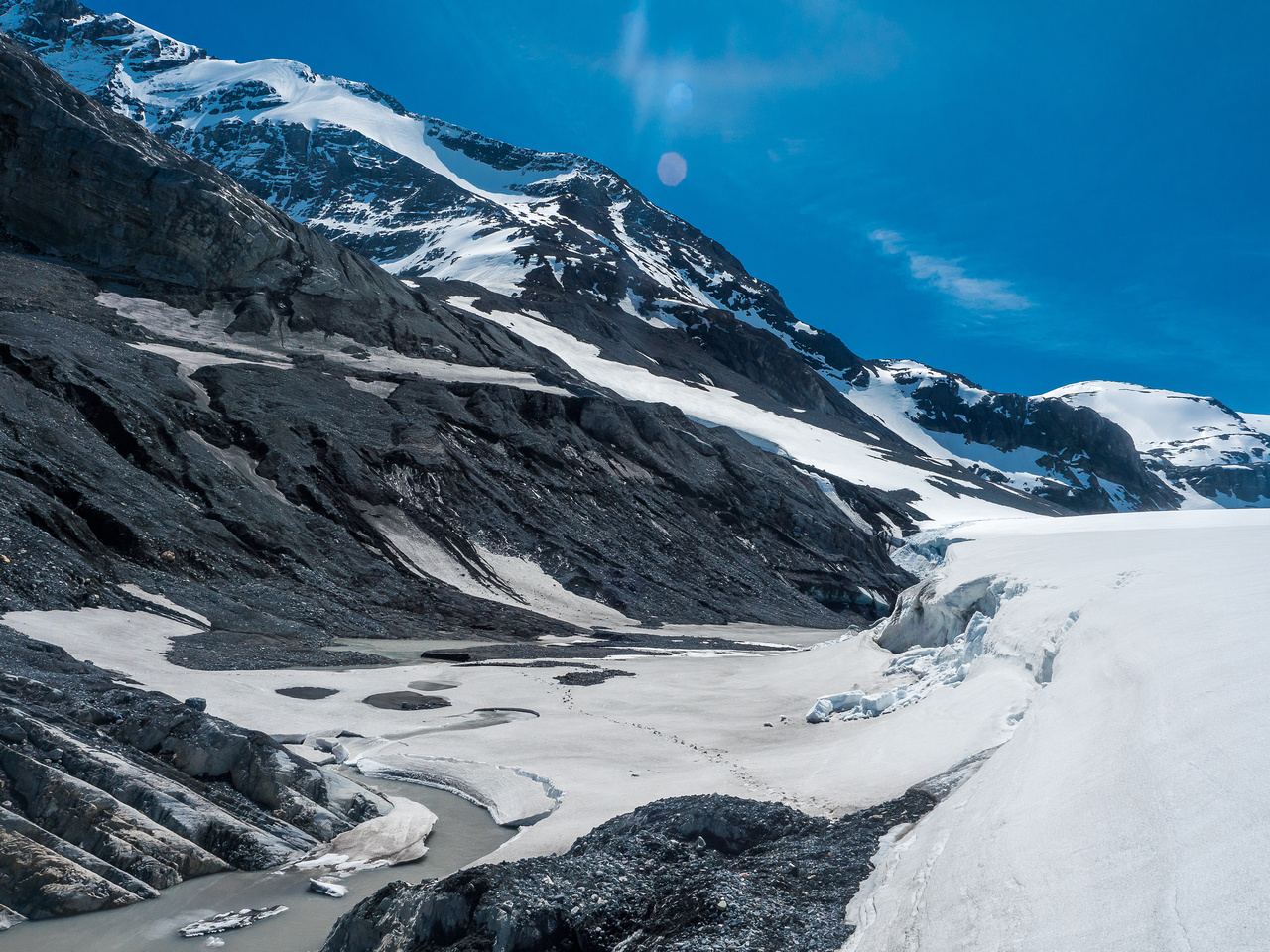 Looking back at our tracks crossing the Mons Glacier outflow stream.