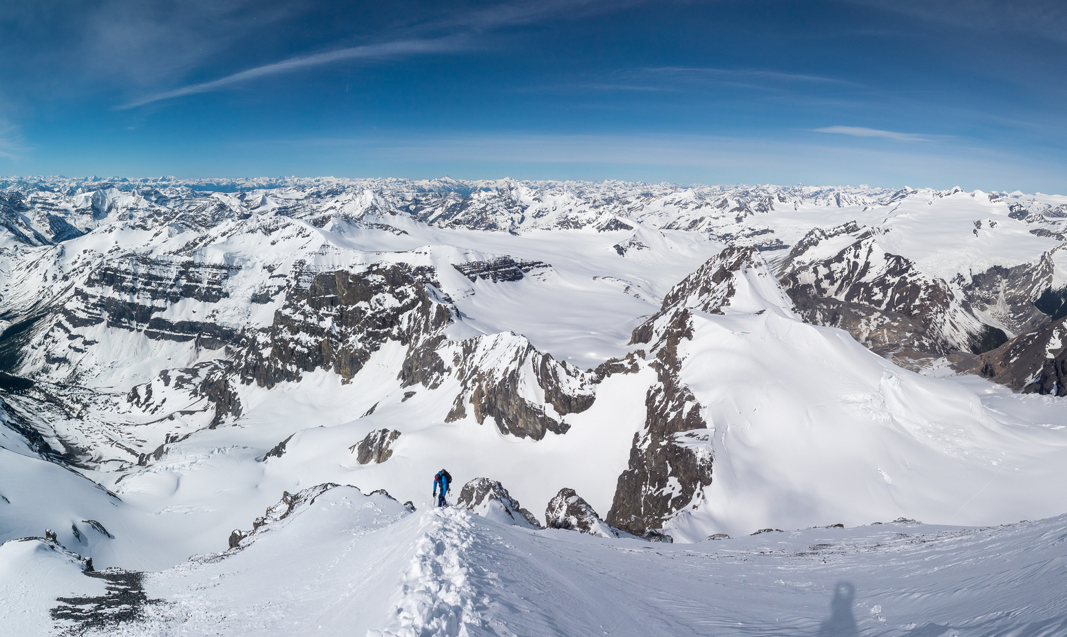 """Anton descends the snow arete that gave us wind slab issues on ascent - thanks to our """"cornice hockey"""" on the way up, it was a breeze to descend."""