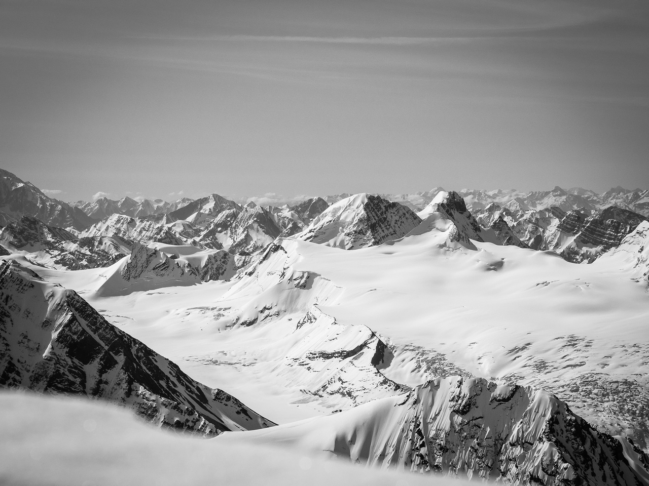 Mount Mummery and the Freshfield Icefield to the south over the summit cornice.