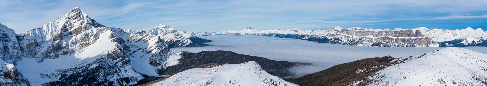 The inversion layer of clouds over the Bow Valley makes for dramatic views.