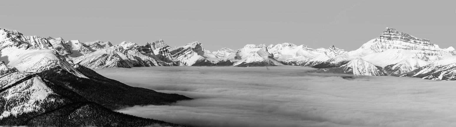 Looking over the inversion past Mount Hector and up hwy 93 to Bow Peak at center and Waputik at left