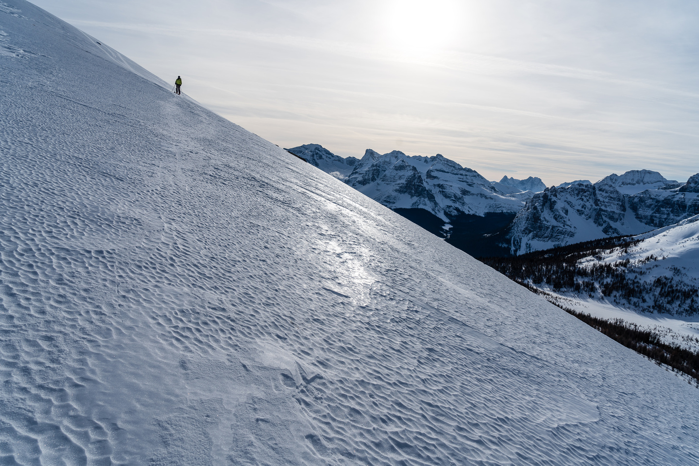 Descending the icy summit slopes.
