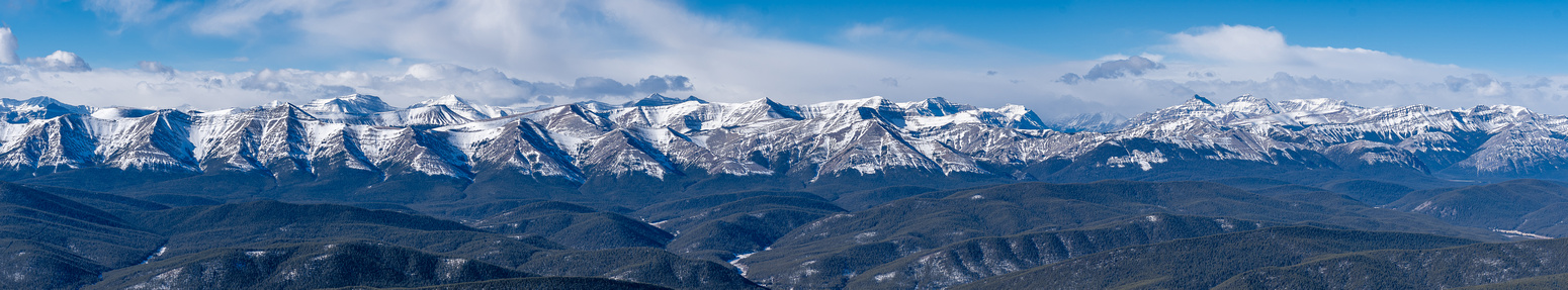 Impressive views west to mostly unnamed and untamed peaks. Wapiti, Tomahawk and others visible.