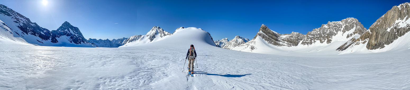 Skiing on firm snow towards Haig Ridge with the expansive Haig Icefield spread out around us.