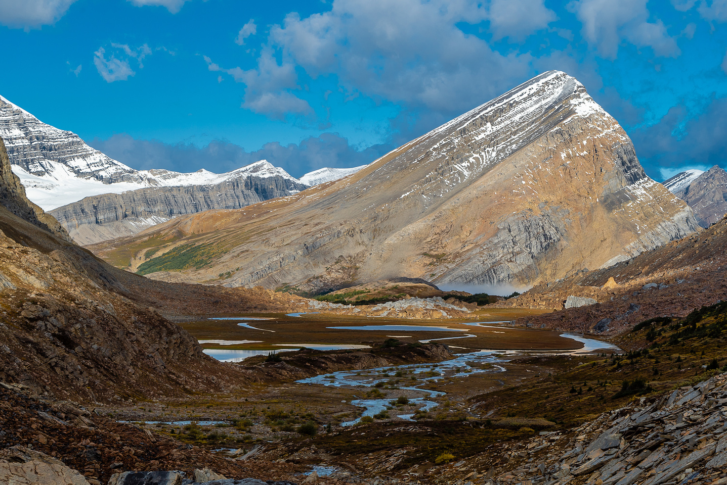 """Hiking down the Brazeau River from Cataract Pass. """"Nosecone Peak"""" in the distance."""