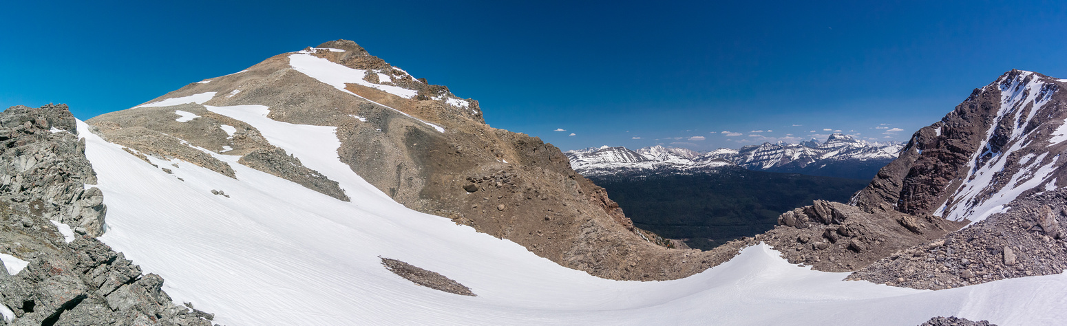 Looking up to the summit (L) from the col. South summit at right.