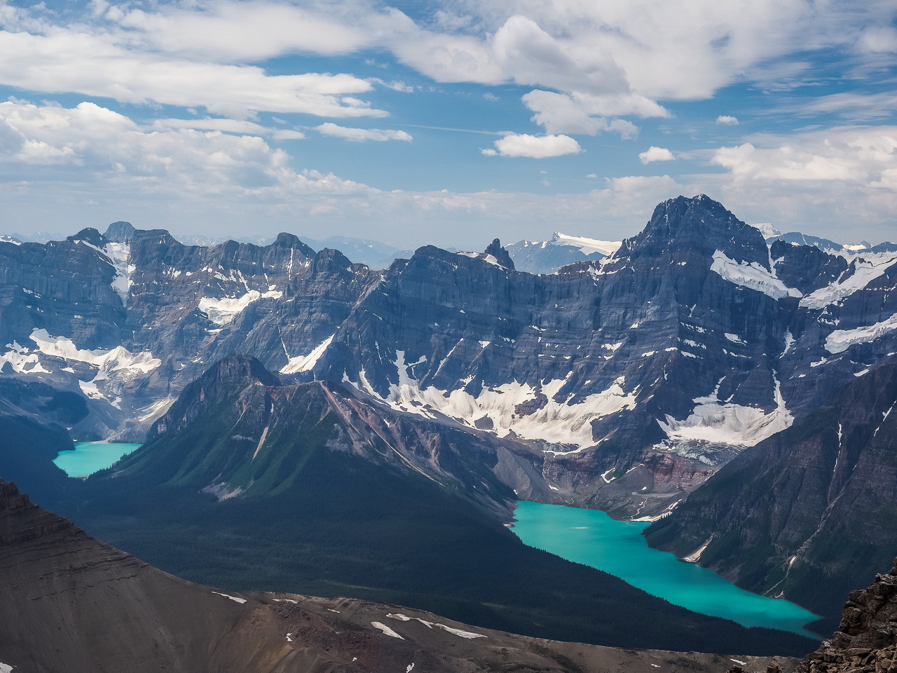 Breaker Mountain rises above Aries and Ebon Peaks and Cirque Lake at left. Aiguille's distinctive summit at center right and Howse Peak rises above the brilliantly colored waters of Chephren Lake at r