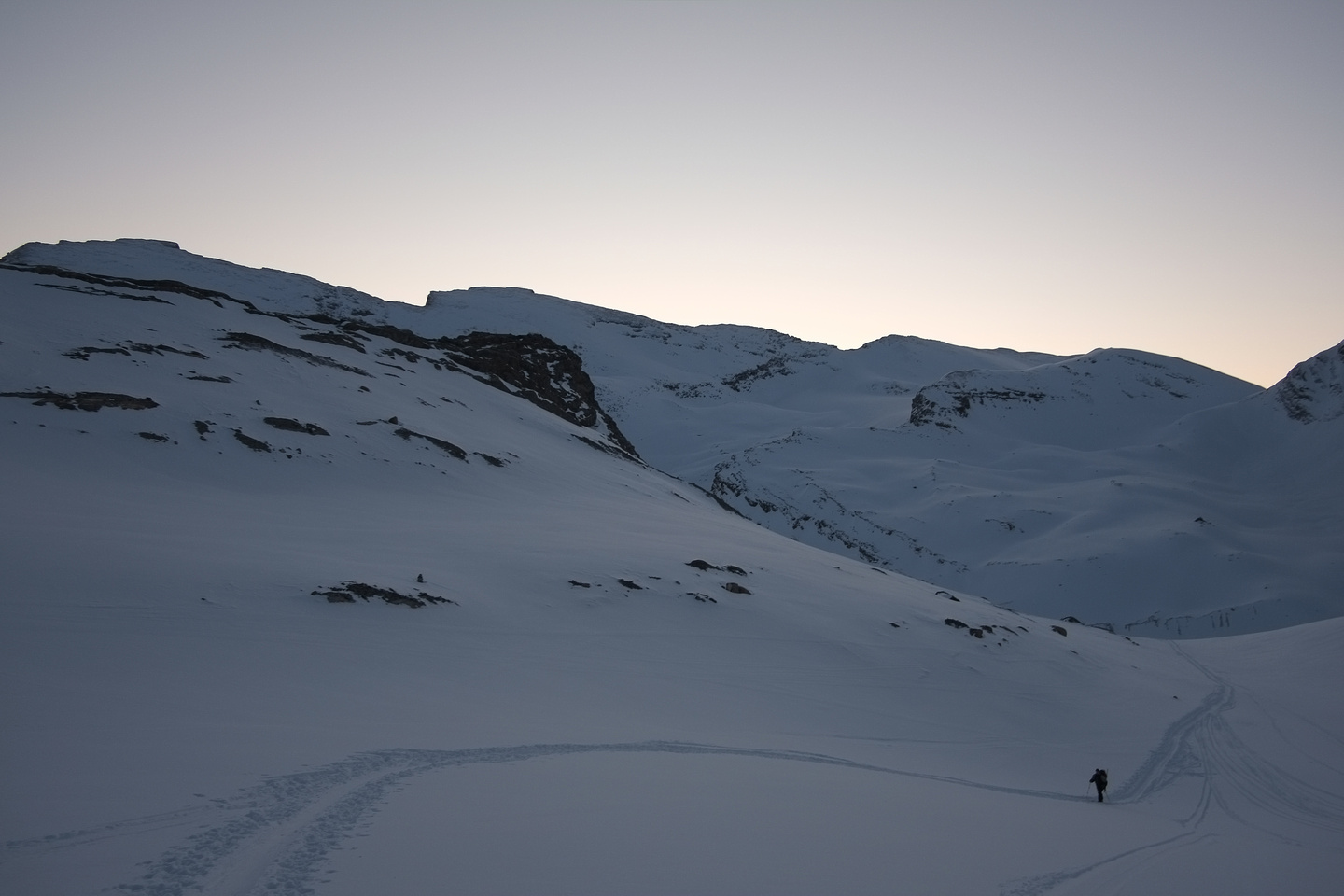 Above the lower headwall, Kev approaching the Bow Hut in evening lighting.