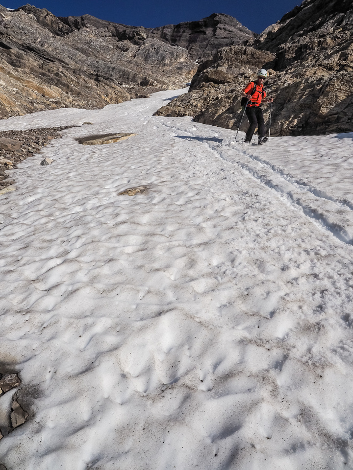 A delightfully quick descent utilizing the snow in the lower gully.
