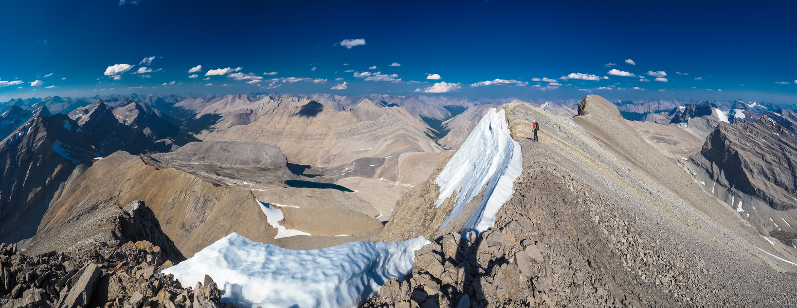 Phil traverses towards the summit with this stunning view north over the Roaring Creek Valley.