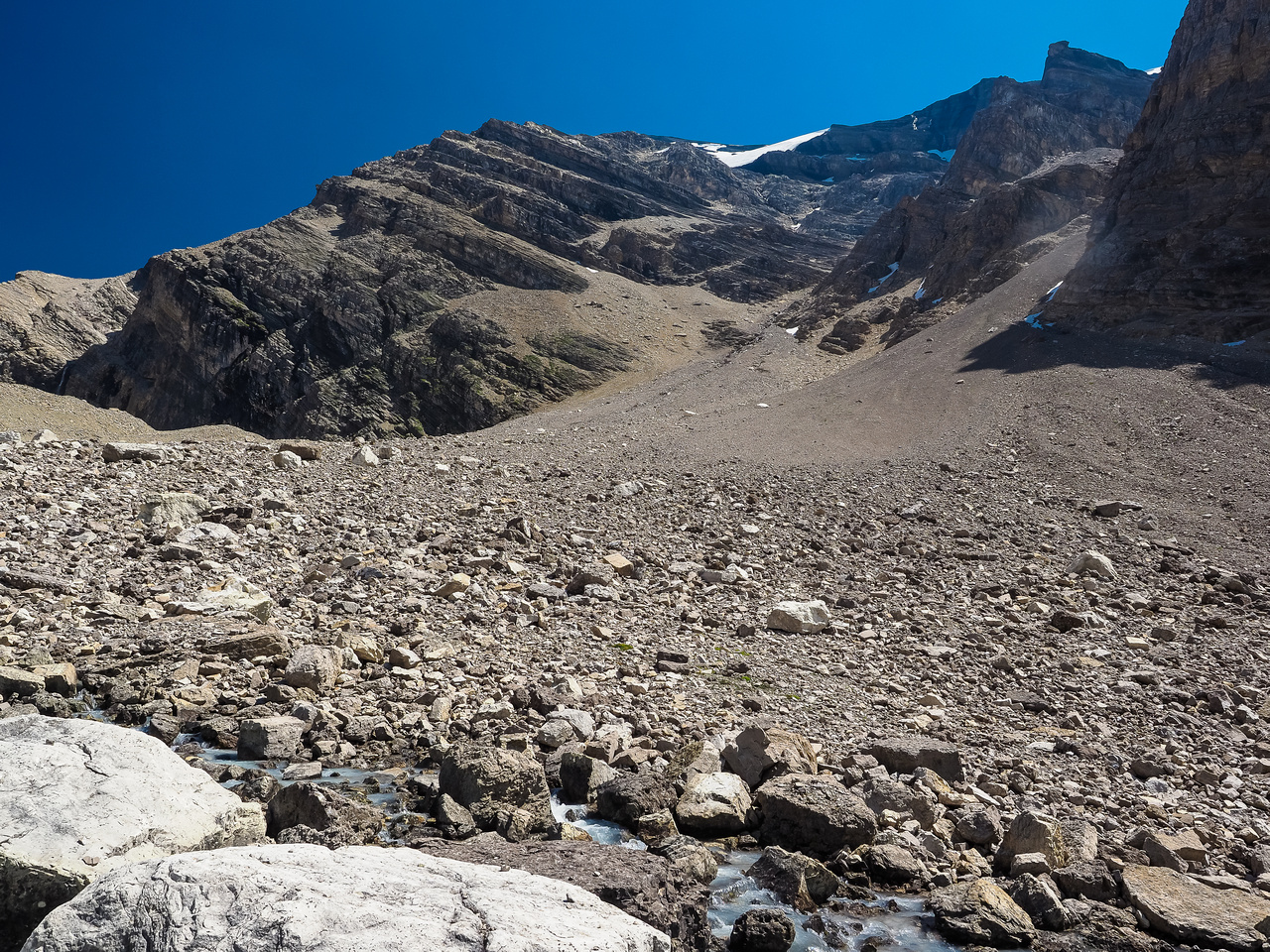 Cataract Peak looms over the stream from just beneath our bivy ridge. The obvious scree gully beckons us onward.