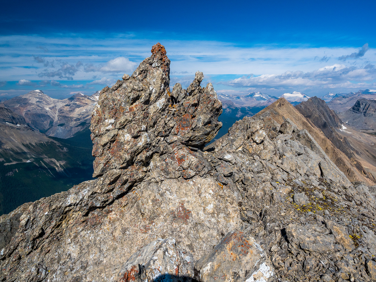 This is the pinnacle / boulder that is visible on top of the crux.