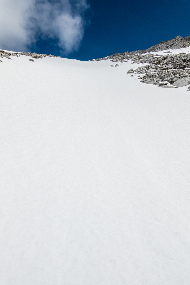 Using snow to ascend the south bowl to the summit.