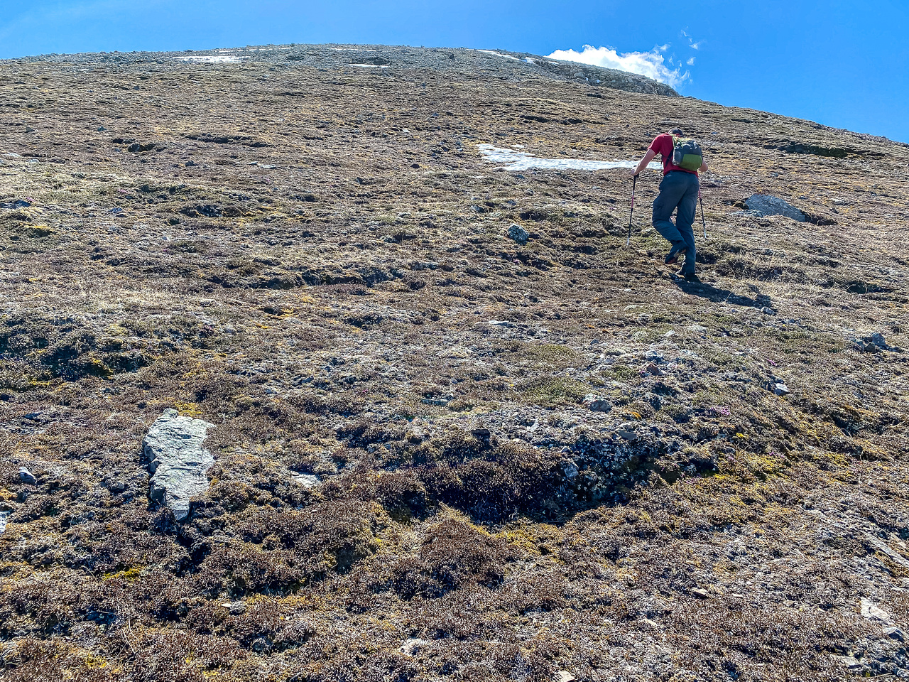 Hiking up steep slopes to the upper east ridge.