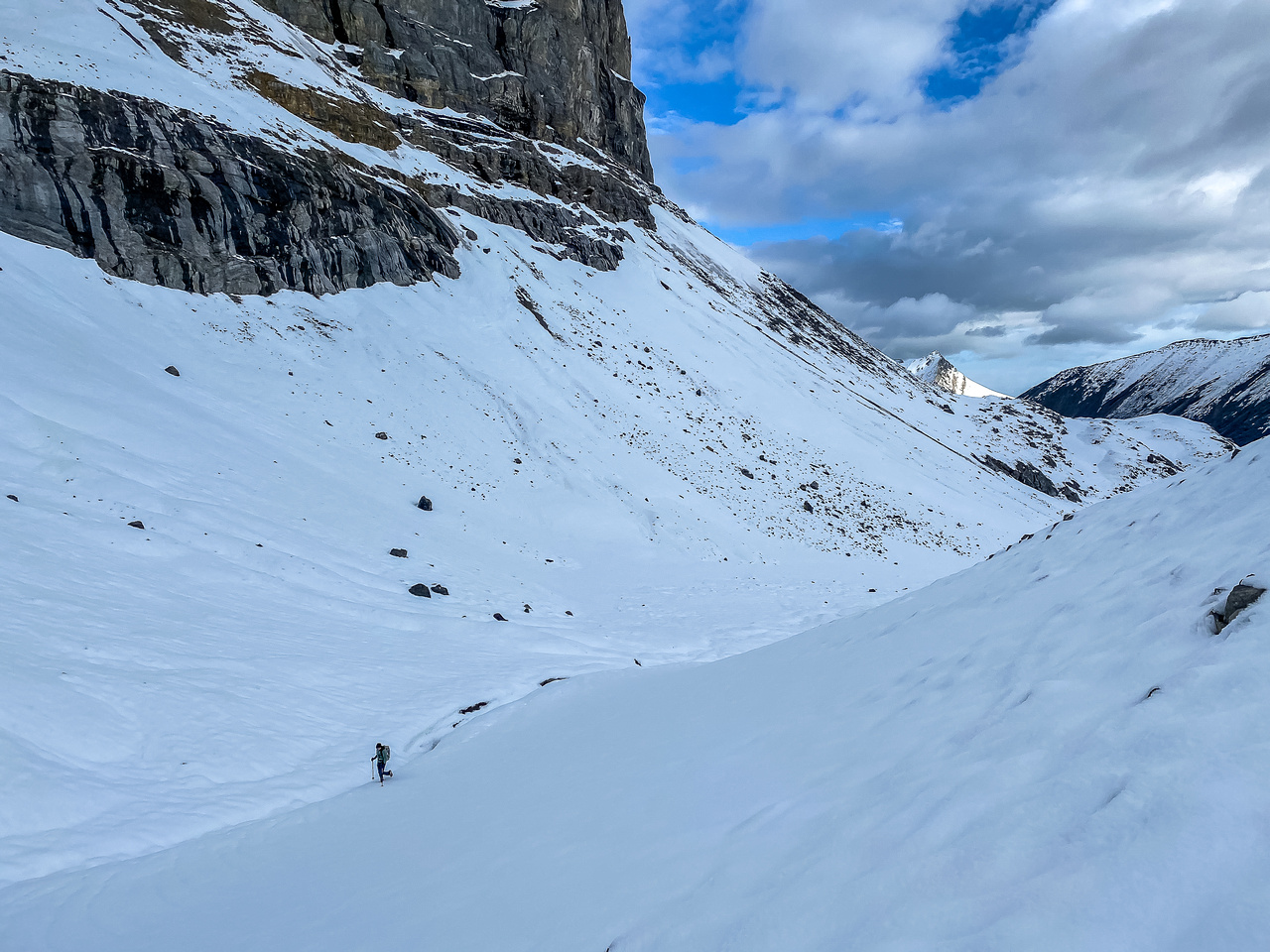Hiking on snow beneath the west ridge leading up to the summit.