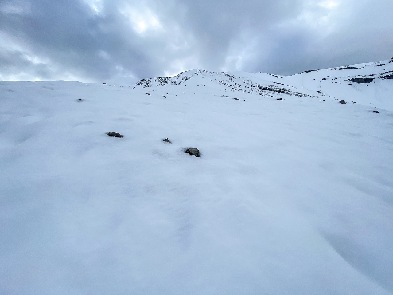 Looking up the very foreshortened and very snowy (!!) west ridge to the summit.