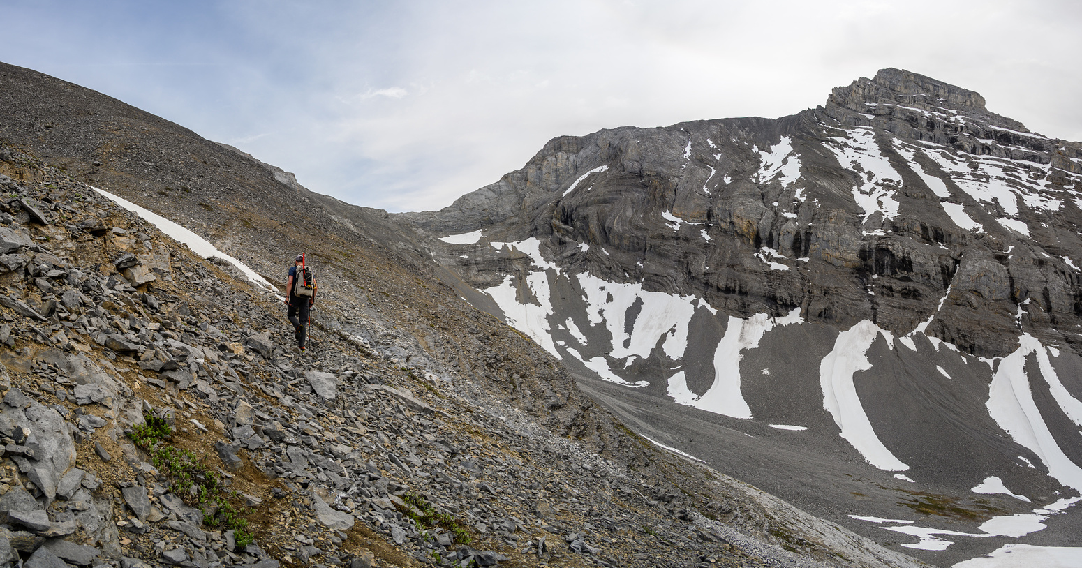 Hiking up the scree bench to the SE ridge. Solstice Peak at right.