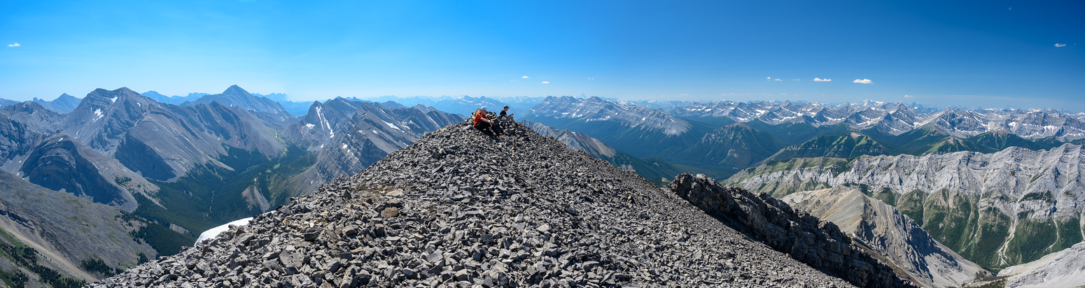 An awesome, windless summit with views of Revenant and Aylmer (L).