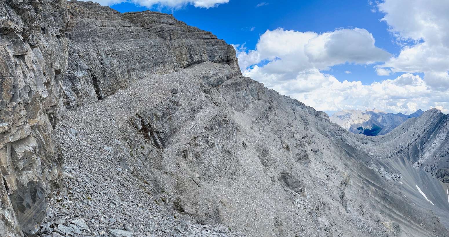 The only break in the summit cliffs is just ahead trending left of the scree ledge.