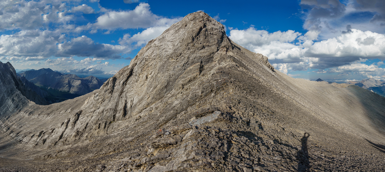 Thankfully the difficult upper SW ridge can be bypassed on scree at climber's right.
