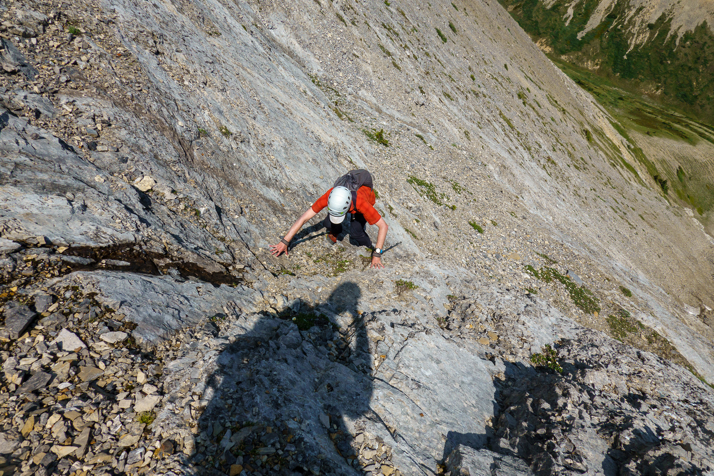 Scrambling up slabs and scree on the east face of Tyrrell.