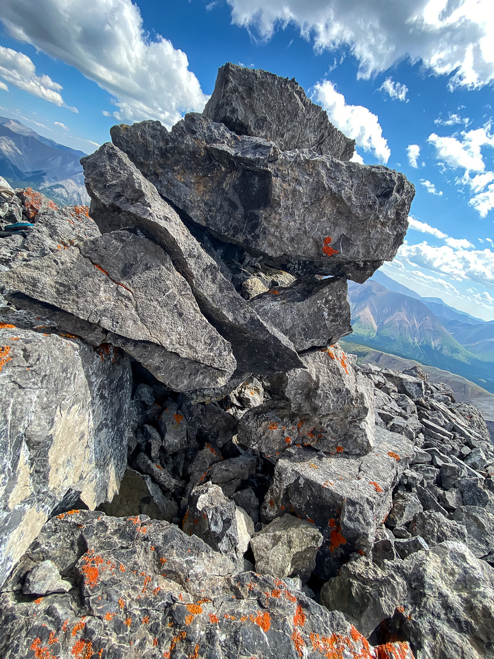 No register and the summit cairn is split open.