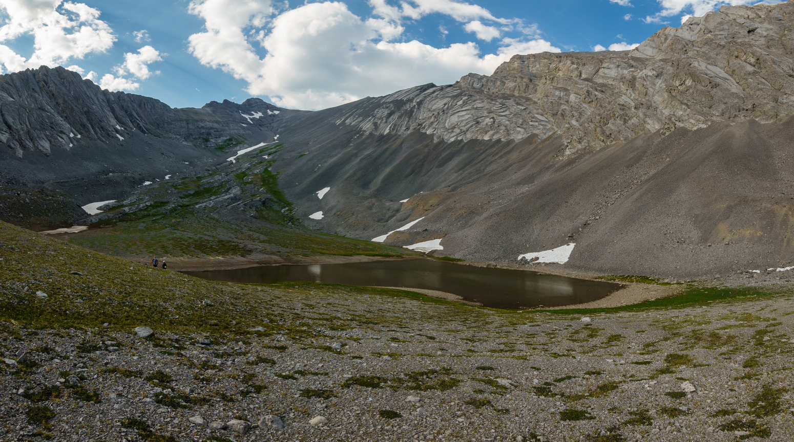 Hiking alpine meadows to the upper Turbulent Lake.