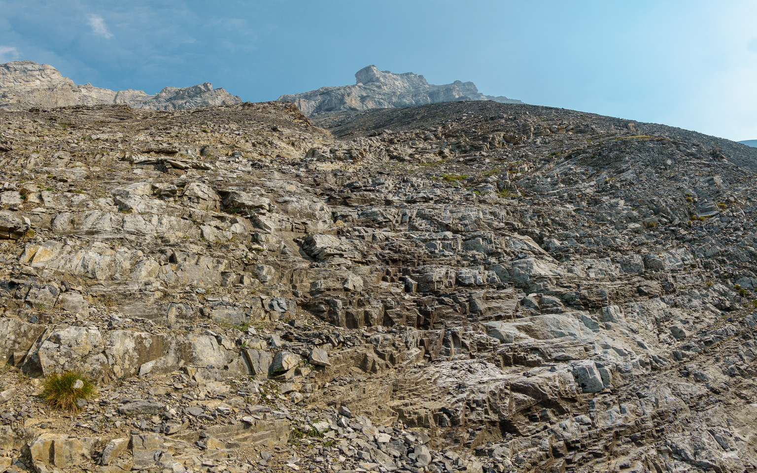 Stepped terrain on the lower south face.