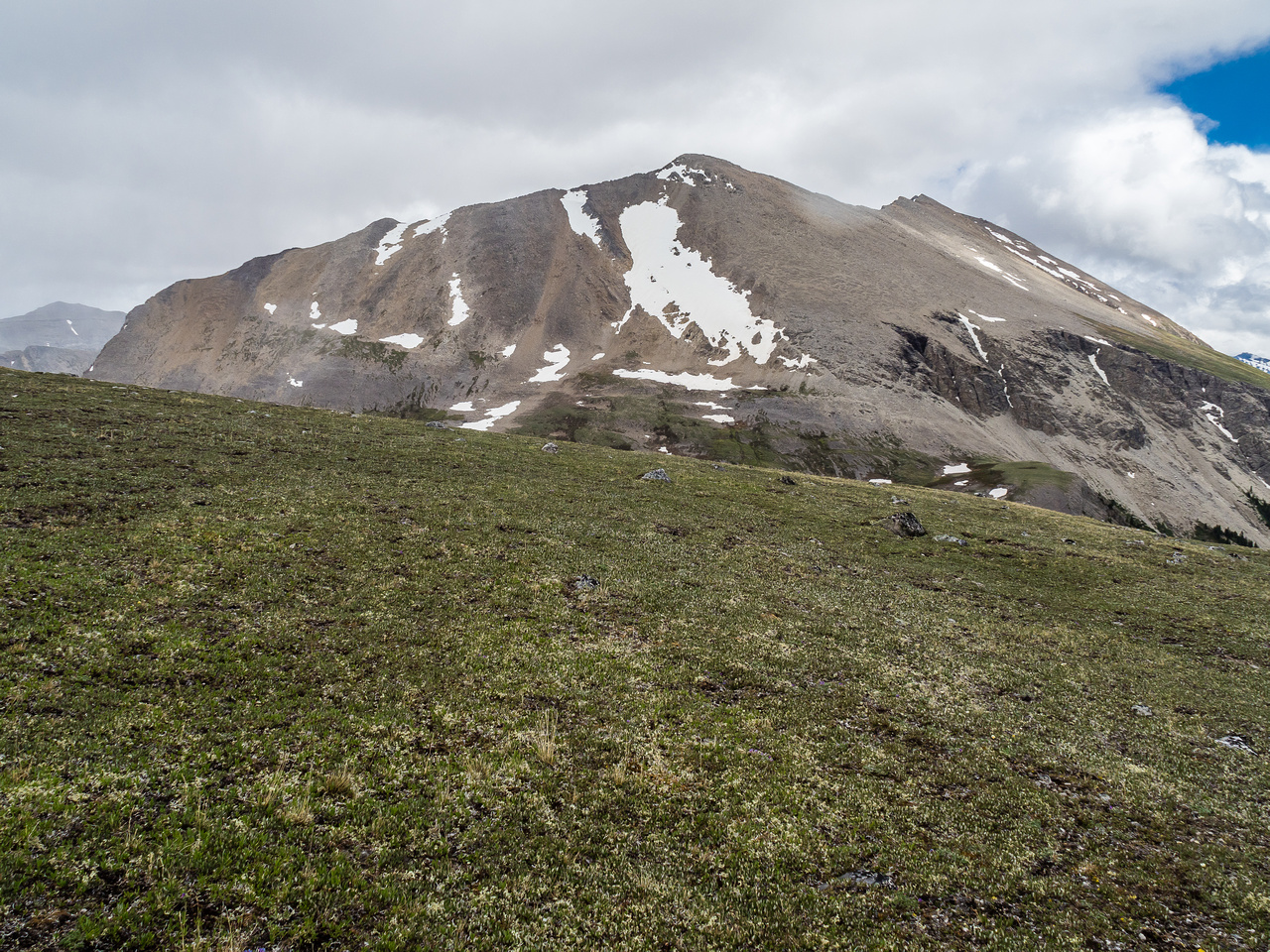 Golden Mountain stretches out from Fatigue Pass. We'll go out of sight to our left before finding an ideal bivy site.