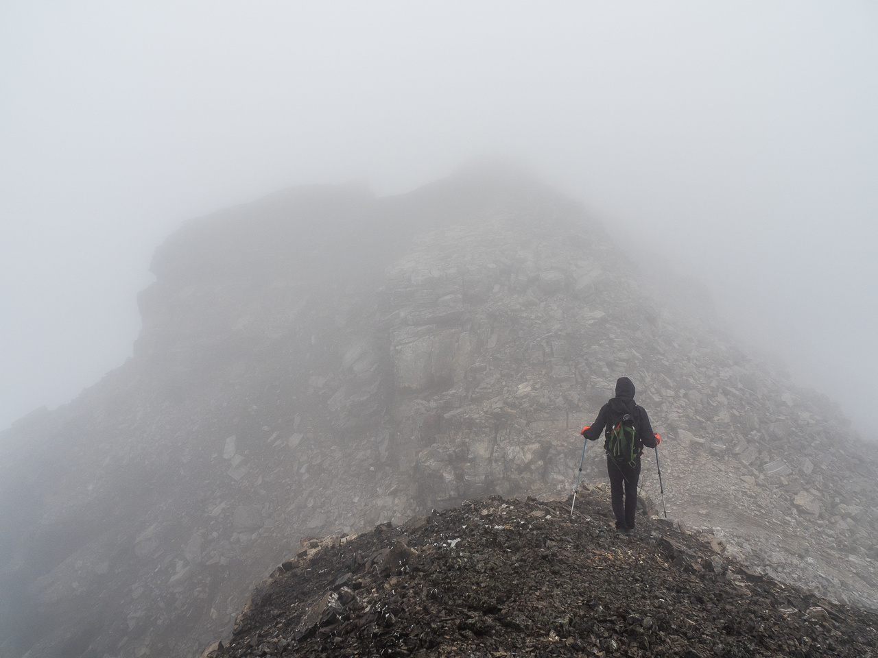 Traversing from the first false summit to what we thought was the true summit block. The true summit requires dropping down a bit to the right here and going just a bit further before ascending back l