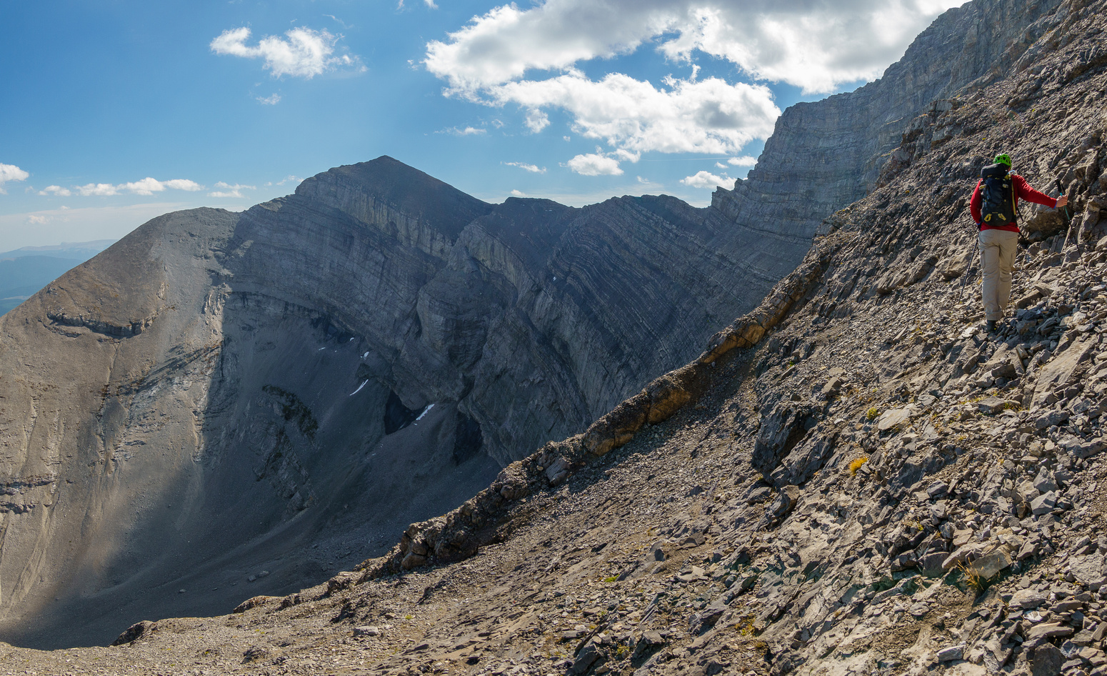 Traversing steep scree to the bench.