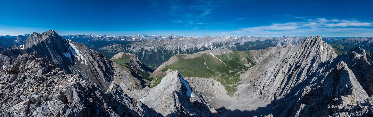 Kananaskis and Spray Lakes peaks including Lawson Ridge and summit at center and many others beyond. Mount Denny at right here with Opal Ridge running off to the right from mid center.