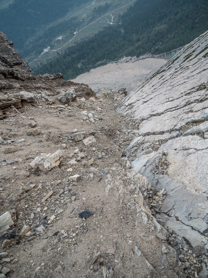 Riding the line between scree and slab, looking down my ascent.