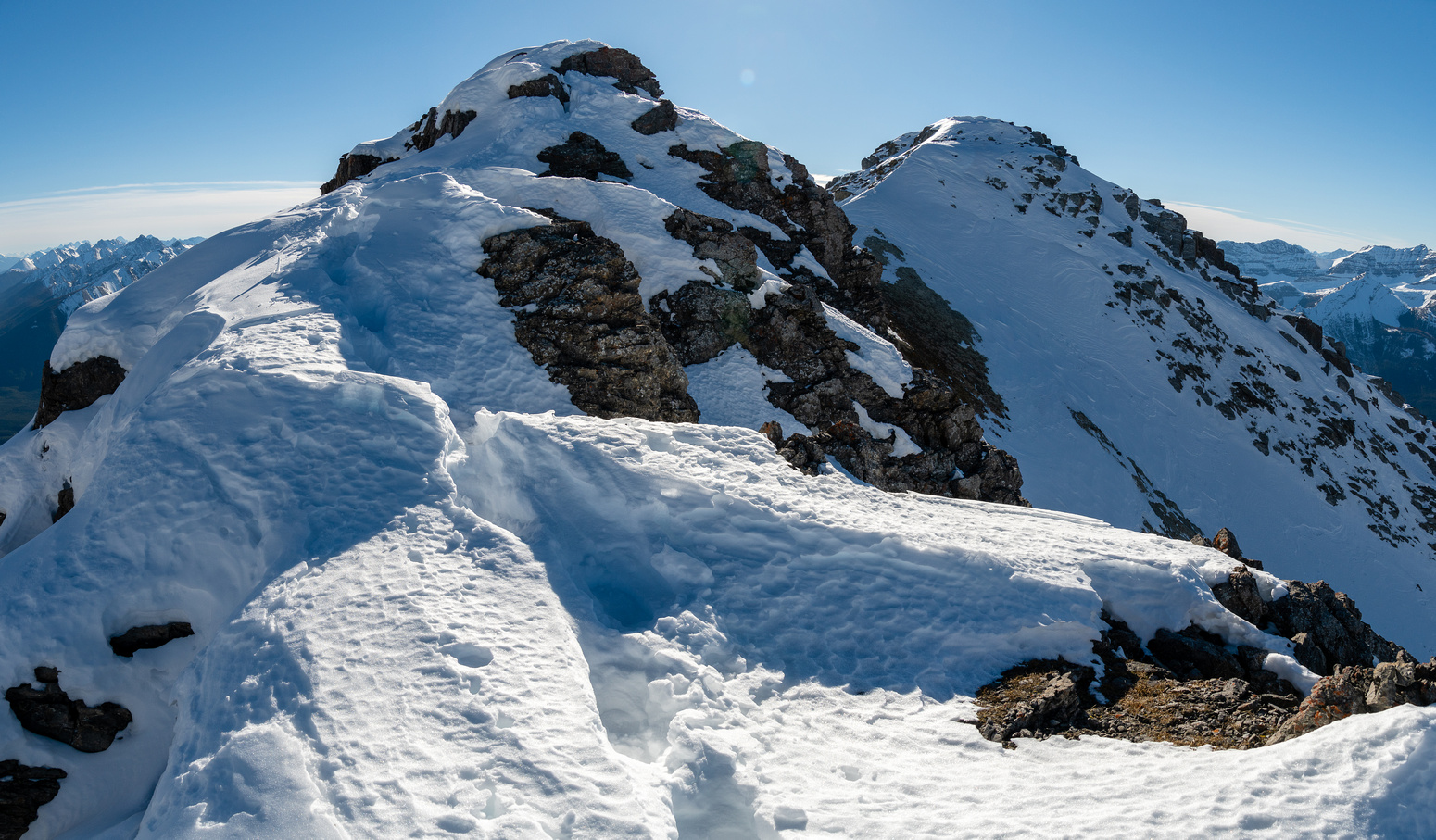 Working my way back along the tricky summit ridge to the false summit.
