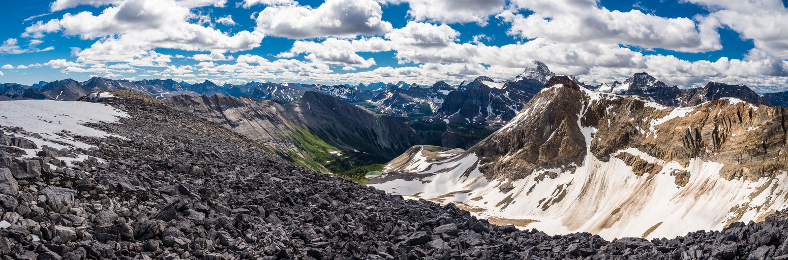 A flat area on the east ridge with views back towards the core Assiniboine area and an outlier of Nestor.