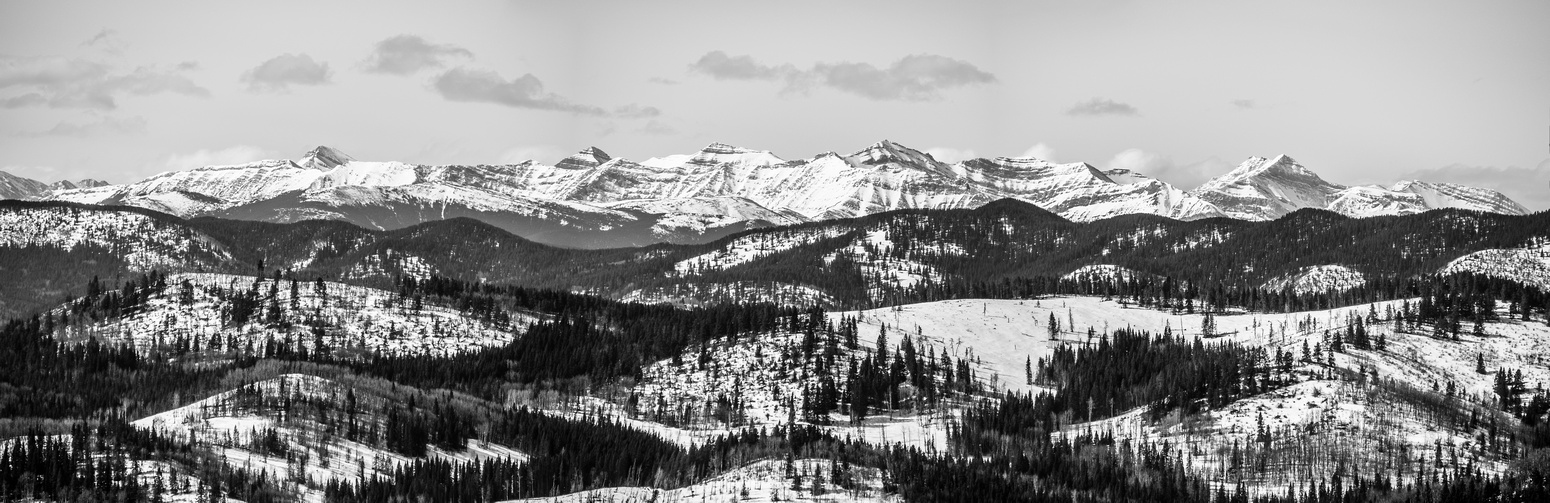 A tele-pano looking west towards peaks such as Burns, Bluerock, Cougar, Rose, Threepoint and others.