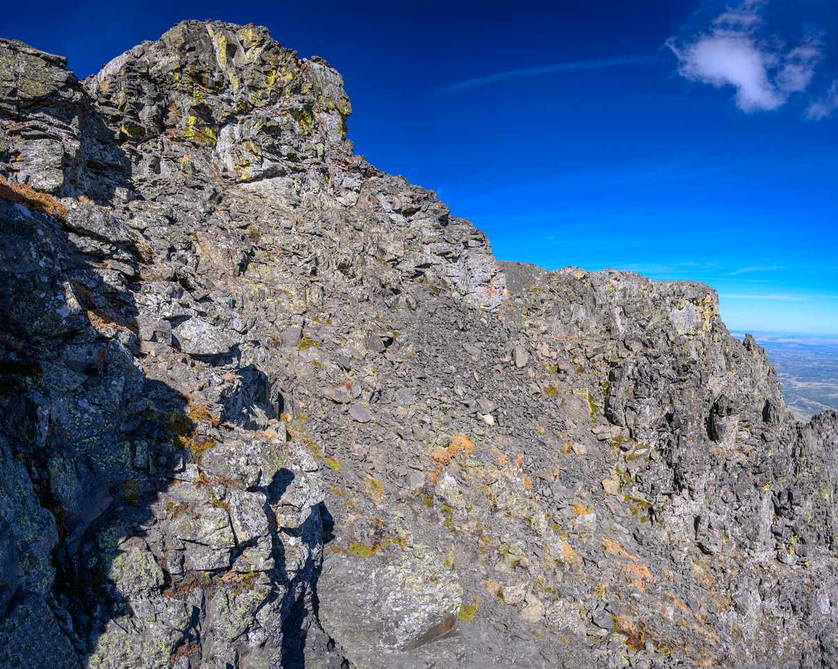 The summit block is intimidating. Route traverses low at right.