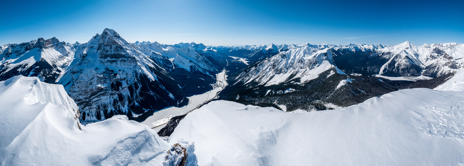 A panorama looking south and west off the summit from Cathedral Mountain at left to Mount Carnarvon over Emerald Lake at right.